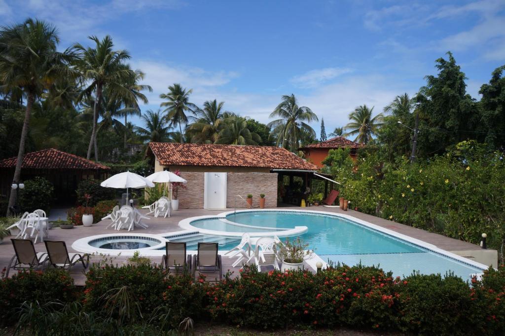 The swimming pool at or near Pousada Vila Marraro