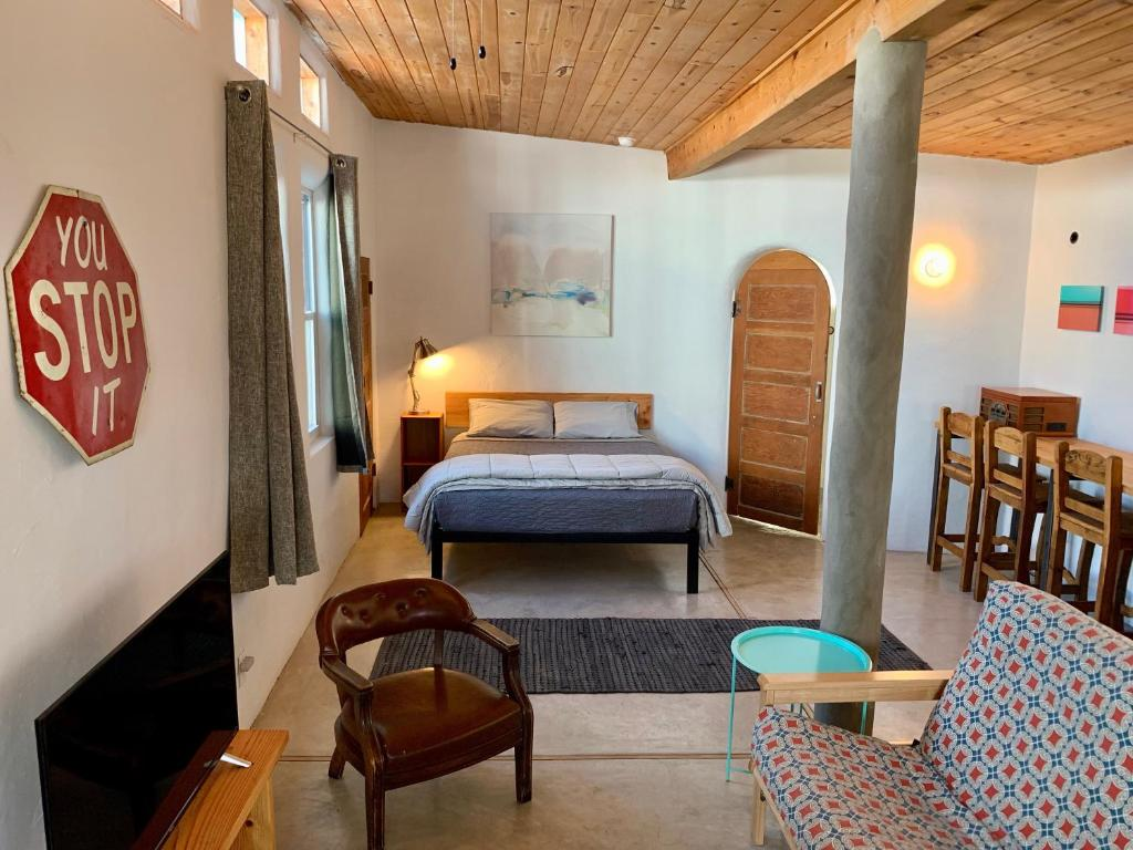 A bed or beds in a room at The Lincoln Marfa