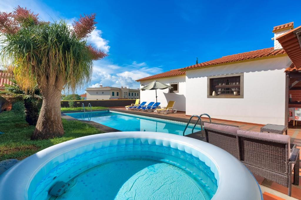 12f35529a The swimming pool at or close to Villa Santo Amaro Private Pool And Jacuzzi