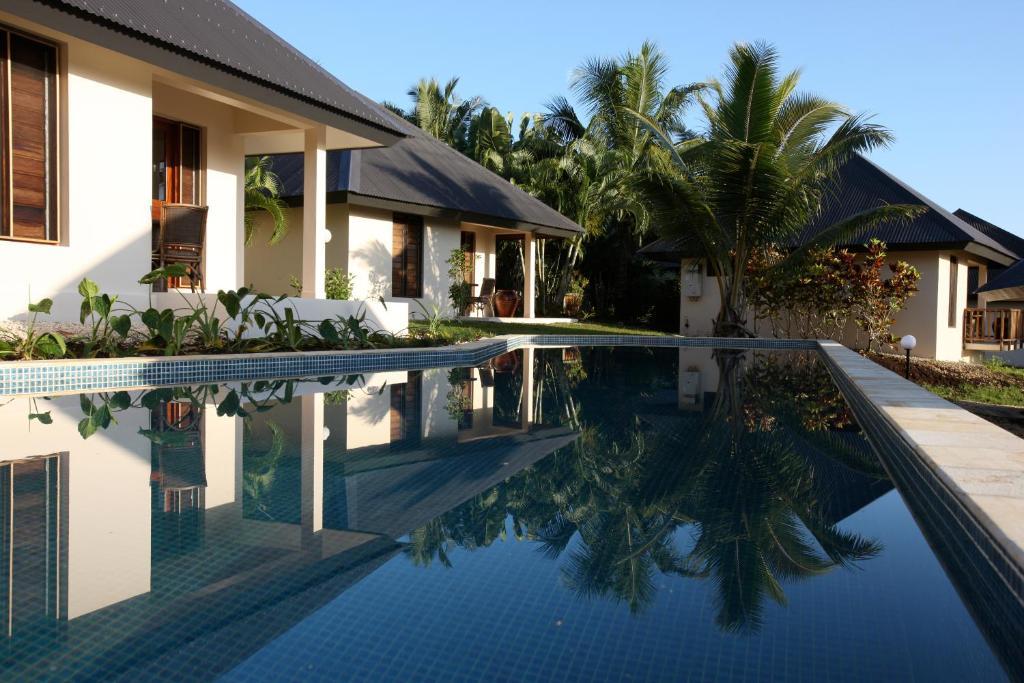 The swimming pool at or near Mangoes Resort