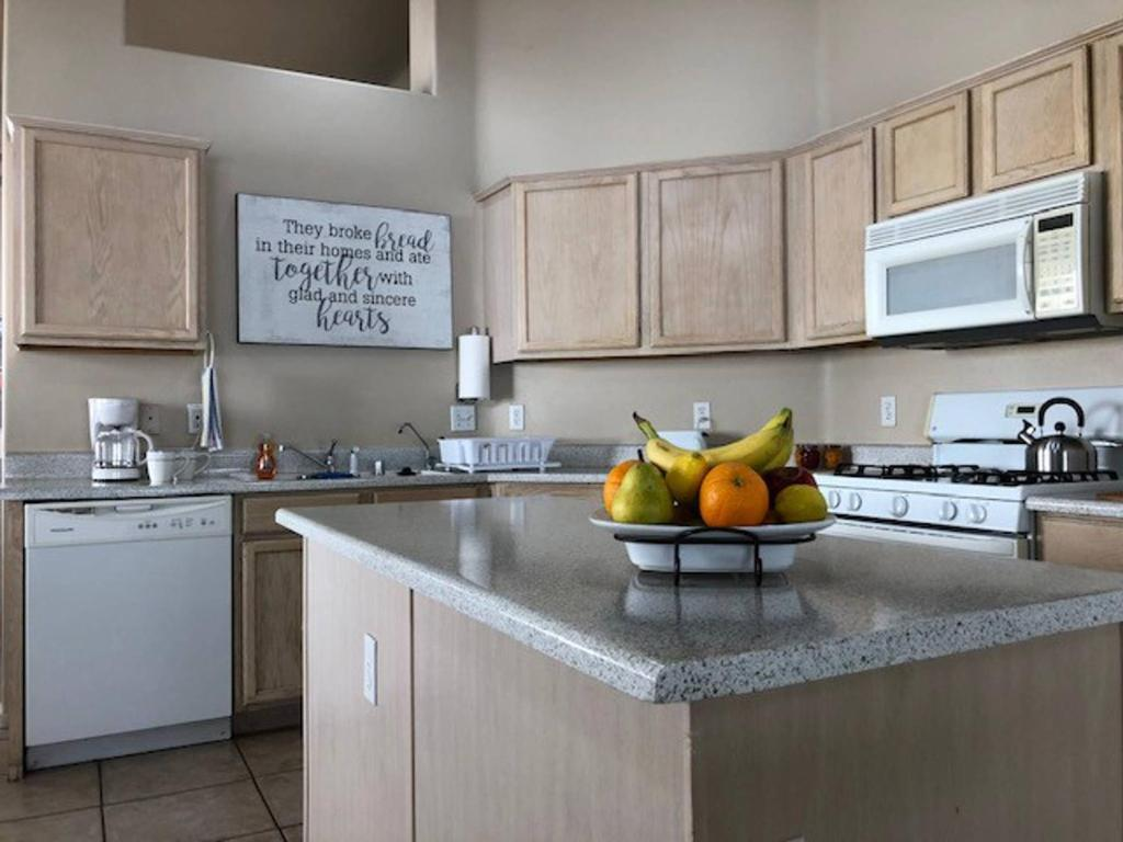 A kitchen or kitchenette at Serene Rio~home~3bed~2bath~spacious~quiet~safe