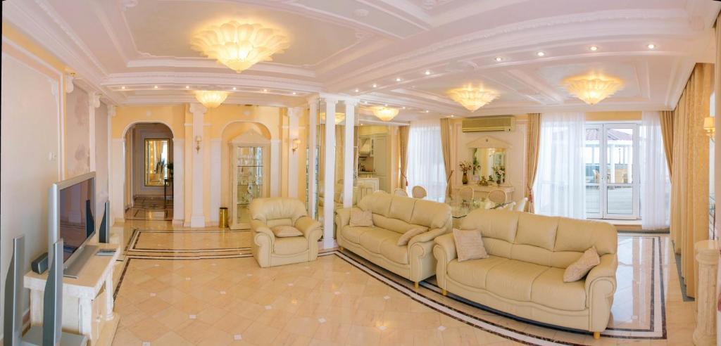 A seating area at VIP Apartment on the sea coast