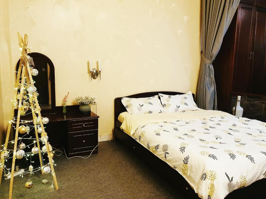 Кровать или кровати в номере Anns home Saigon 450NTMK