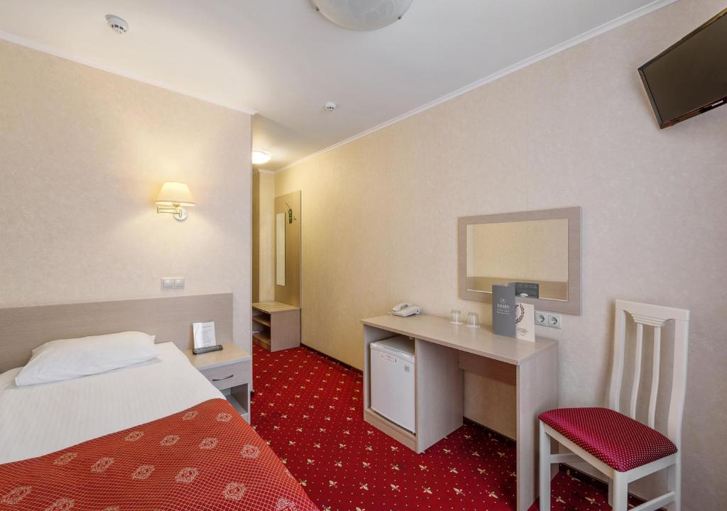 Кровать или кровати в номере АМАКС Парк-отель