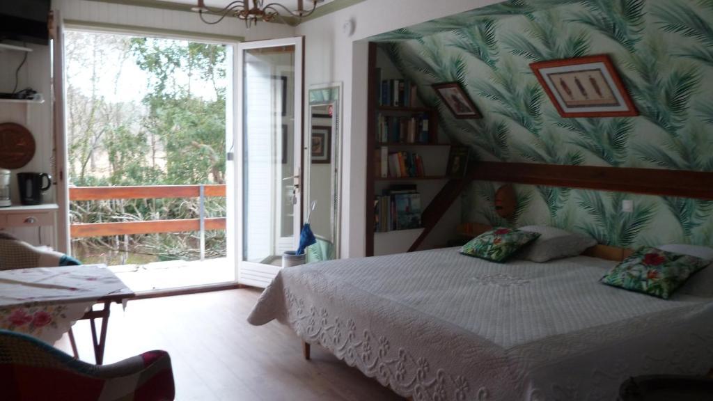 Un ou plusieurs lits dans un hébergement de l'établissement Chambre d'hôte Ker Kristal
