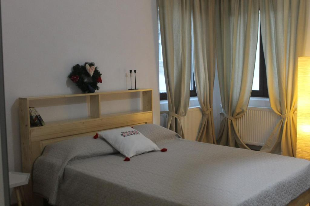 A bed or beds in a room at Casa Bologna
