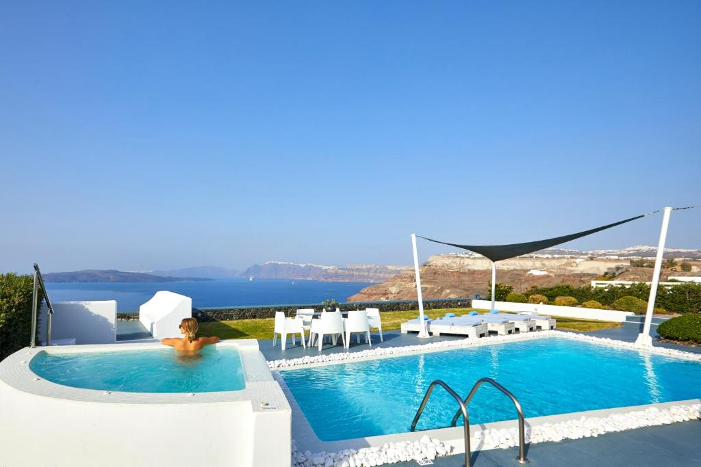 The swimming pool at or near Santorini Princess Presidential Suites