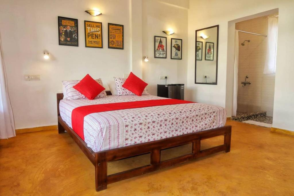 A bed or beds in a room at Arambol Beach Lodge | 3 mins walk to the Beach