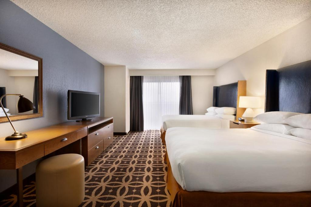 A Television And Or Entertainment Center At Emby Suites Dallas Dfw International Airport South