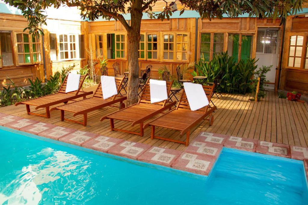 The swimming pool at or near Parron de Colores Hostel B&B