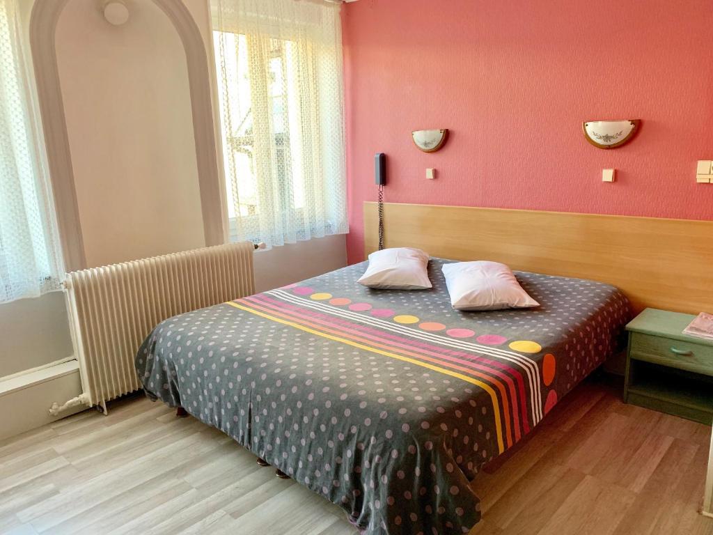 Un ou plusieurs lits dans un hébergement de l'établissement Hotel de l'Academie