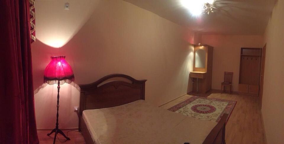 Кровать или кровати в номере Апппартаменты в Элисте