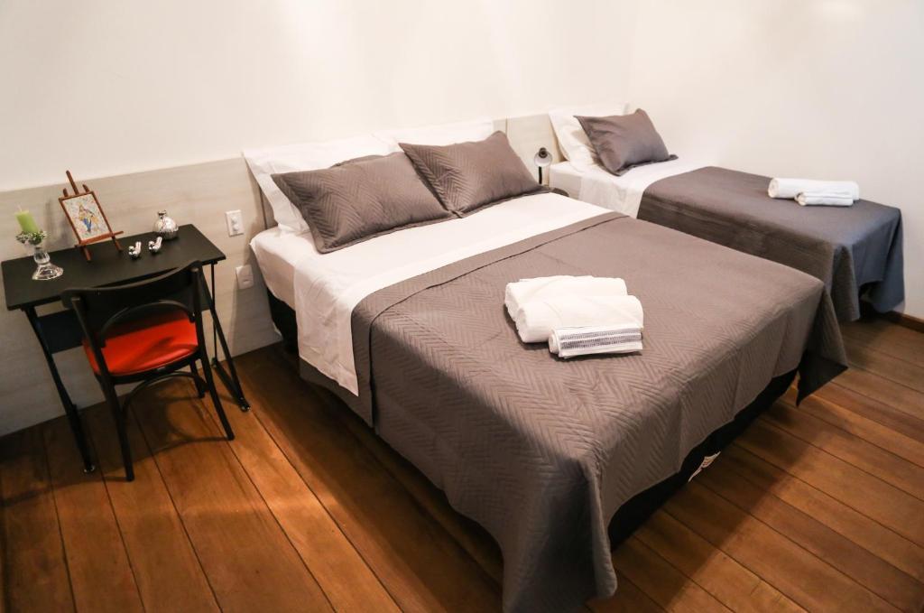 A bed or beds in a room at Pousada da Saudade