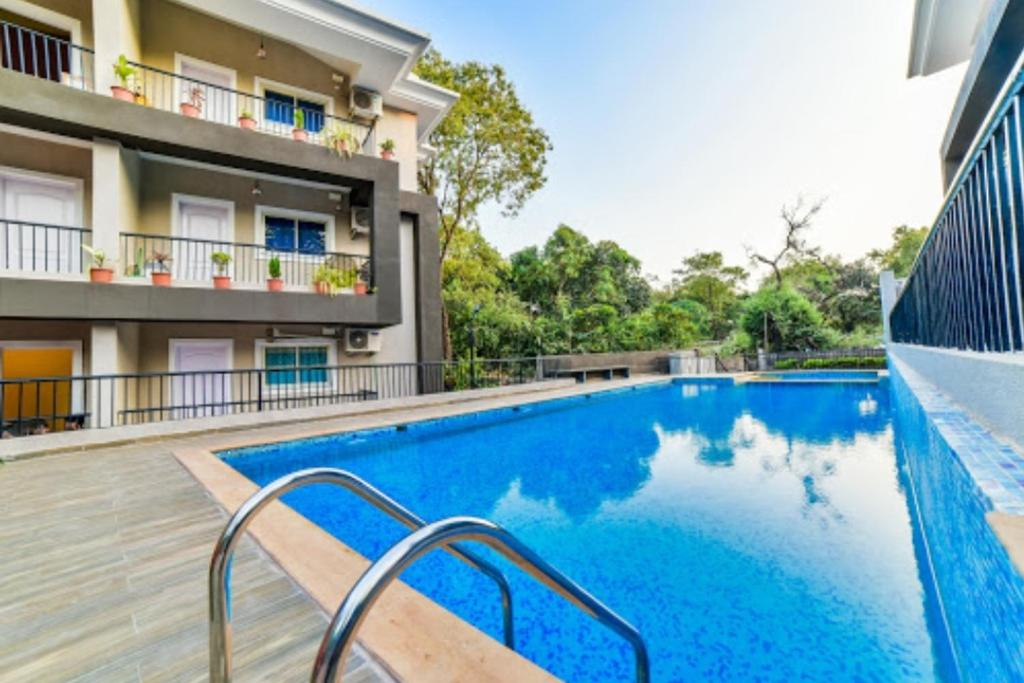 The swimming pool at or near 2BHK Pool view apartment near Vagator beach