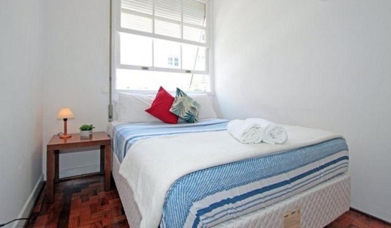 Een bed of bedden in een kamer bij Hostel Bella Paulista