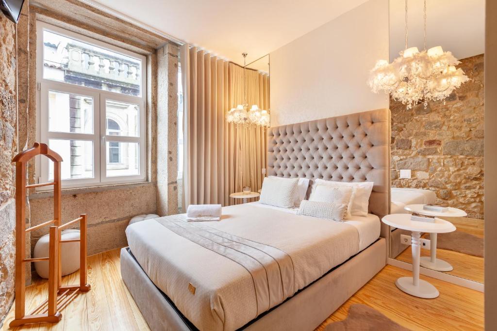 A bed or beds in a room at Berço de Mordomias - Minho's Guest