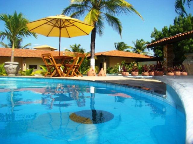 The swimming pool at or near Pousada Casa Dona Rosa