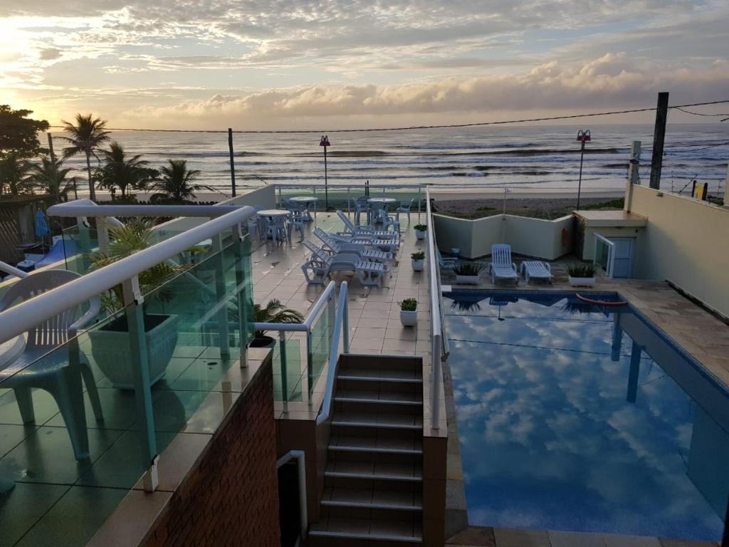 The swimming pool at or near Pousada Elegance Beira Mar