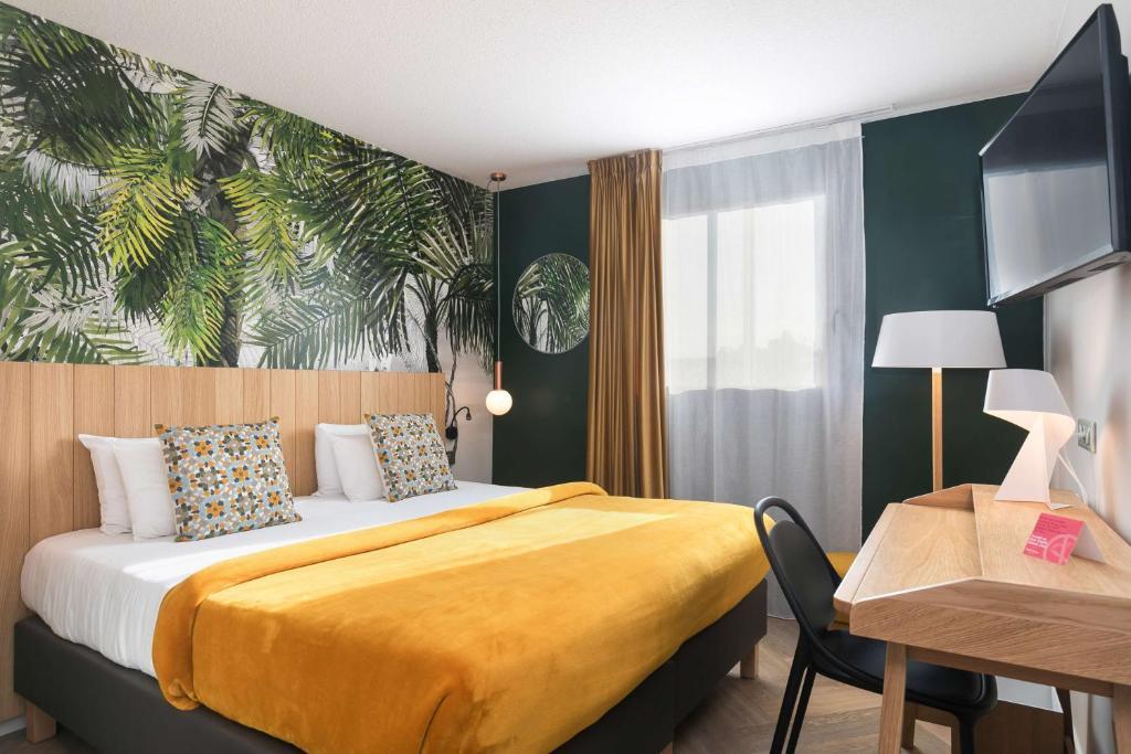 Un ou plusieurs lits dans un hébergement de l'établissement Best Western Hotel Innes Toulouse Centre