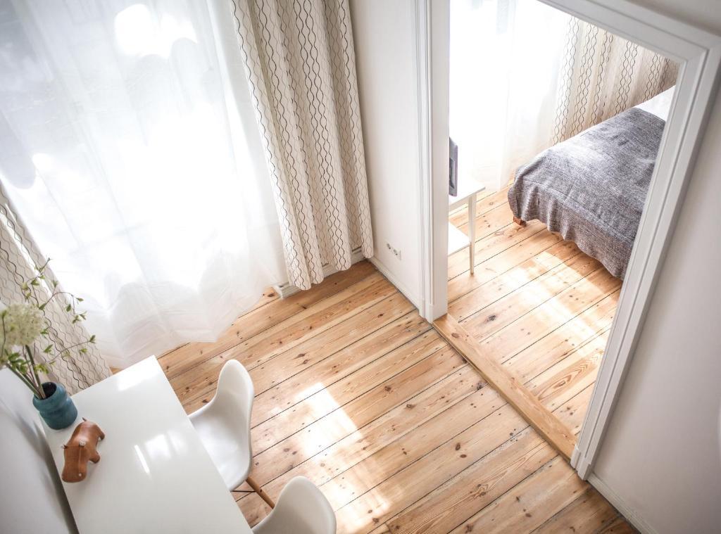 Кровать или кровати в номере Pension Absolut Berlin