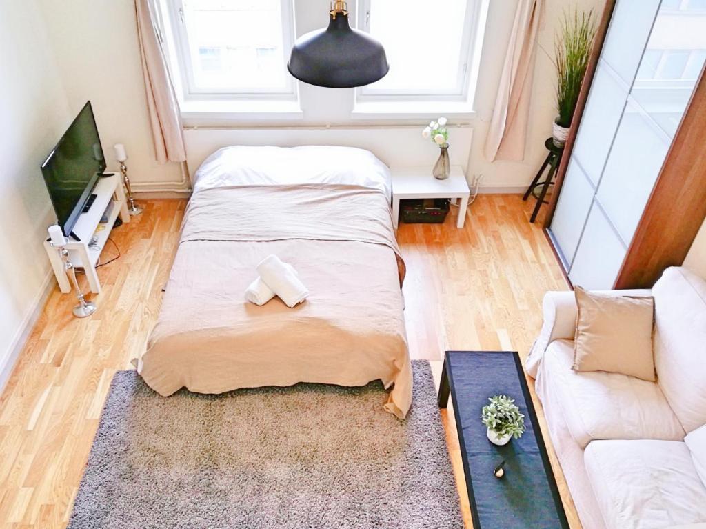 Кровать или кровати в номере Uman City Studio-Flemingsgatan