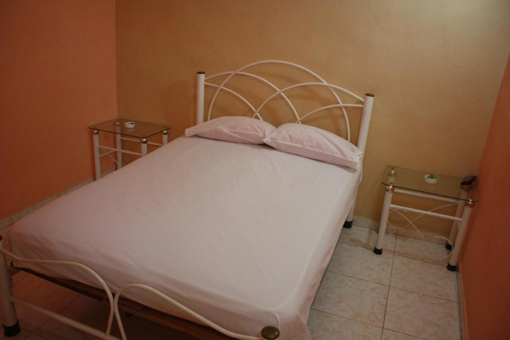 A bed or beds in a room at La Cuevita