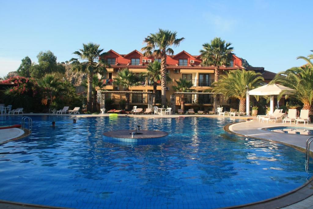 The swimming pool at or near Holiday Calbis Hotel