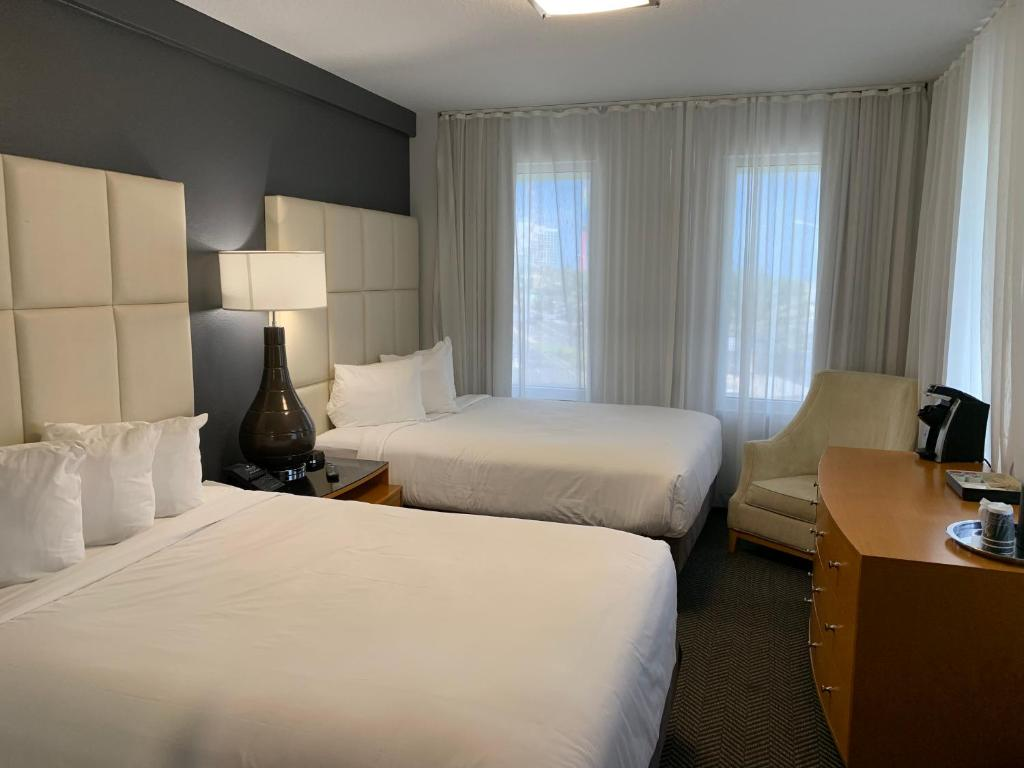 A bed or beds in a room at The Streamline Hotel - Daytona Beach