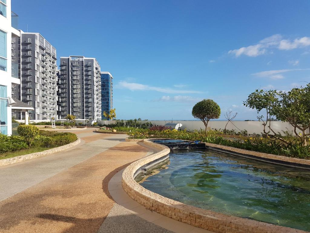 Mactan Newtown Condo with Garden and Ocean View