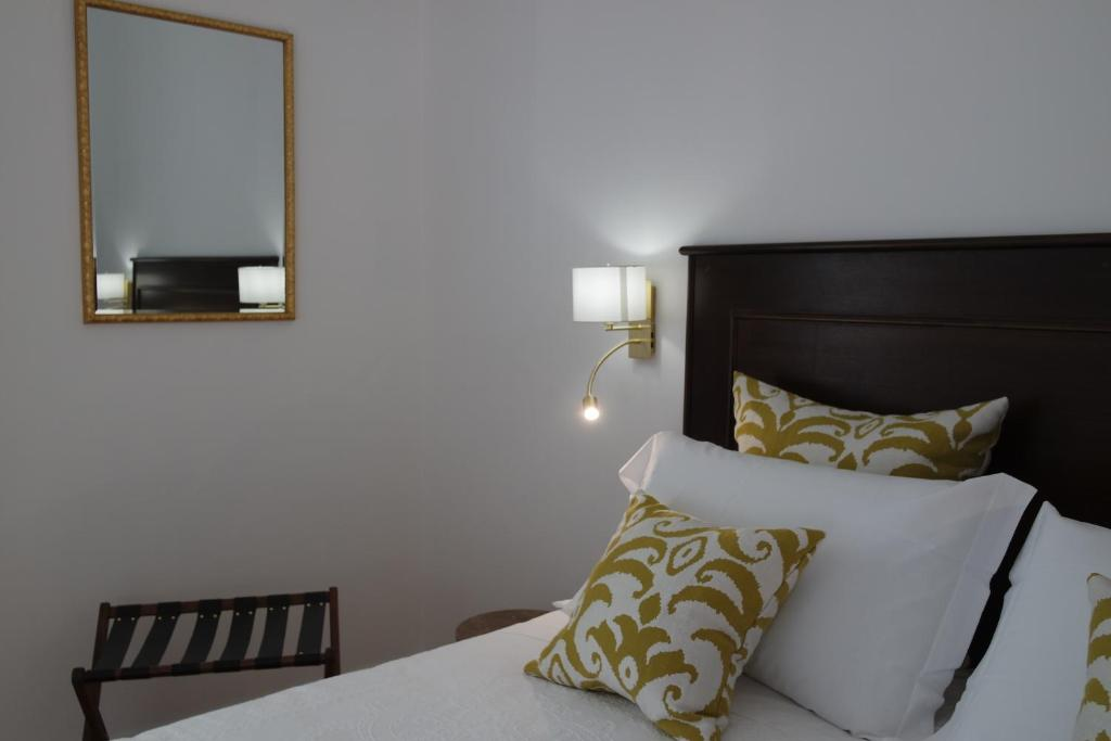 A bed or beds in a room at Hotel Livio