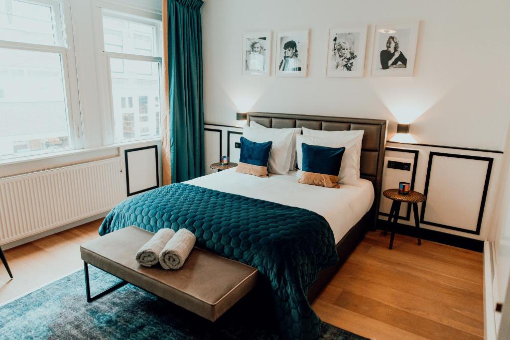 A bed or beds in a room at The Harlemstreet Suites
