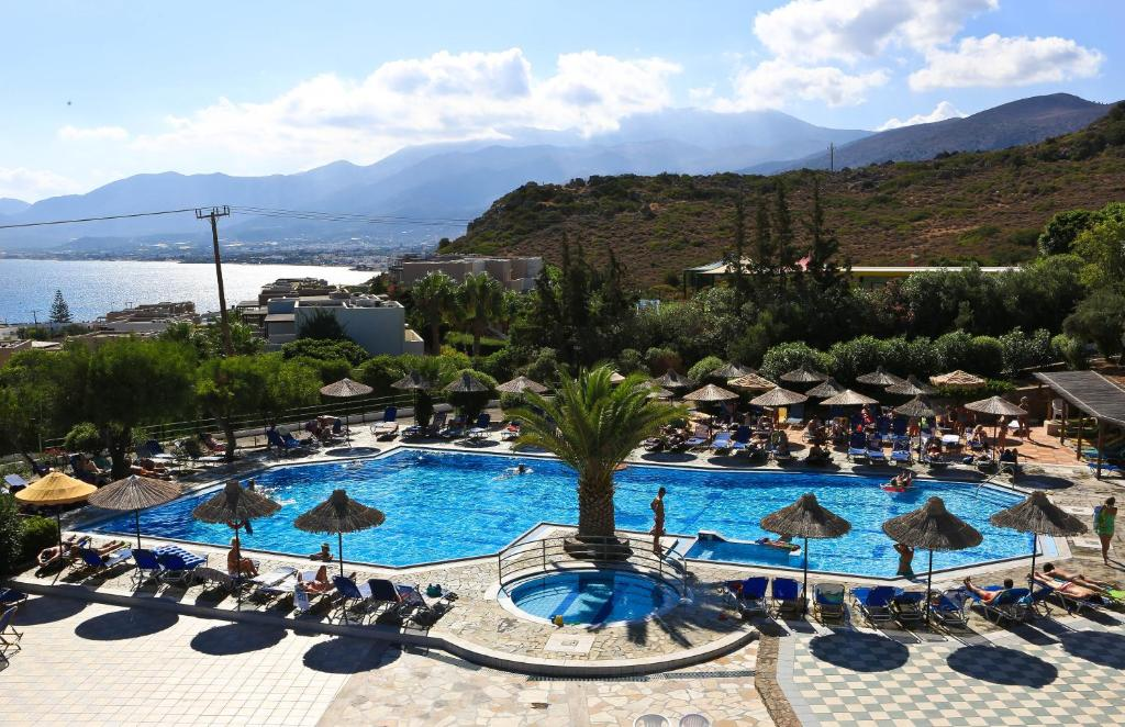 A view of the pool at Semiramis Village or nearby