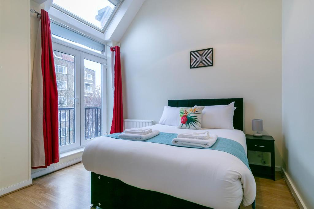 A bed or beds in a room at TCLA - Clapham / Battersea