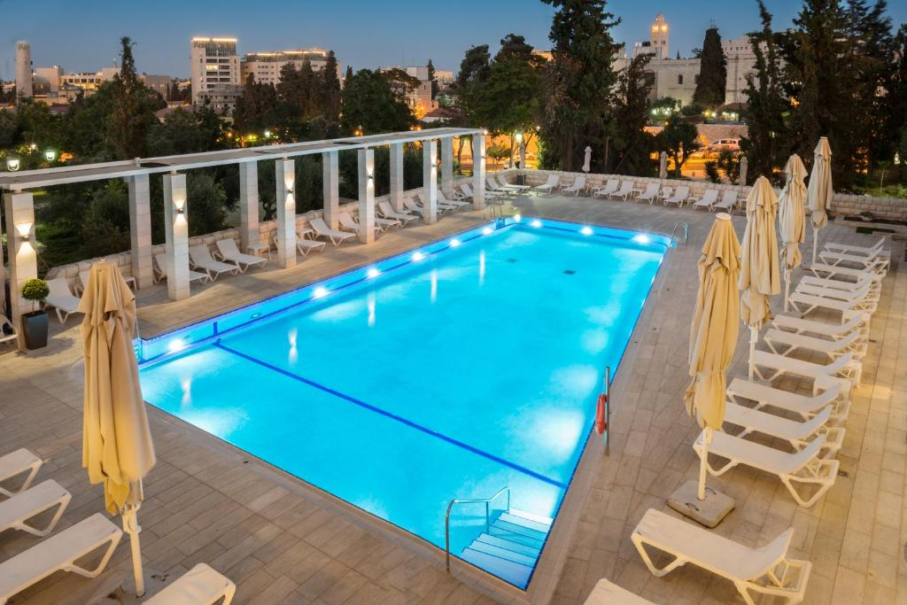 The swimming pool at or near Leonardo Plaza Hotel Jerusalem