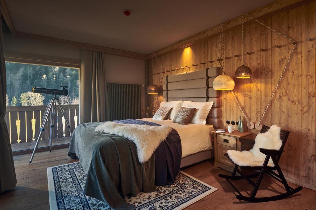 Boutique hotel Vila Planinka tesisinde bir odada yatak veya yataklar