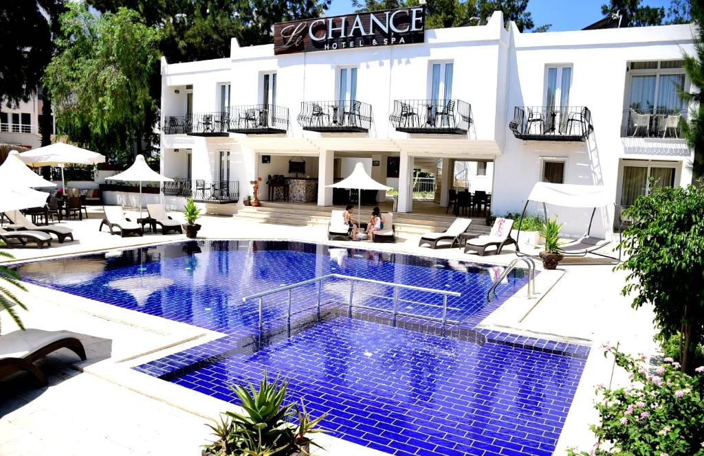 The swimming pool at or near Le Chance Hotel & Spa