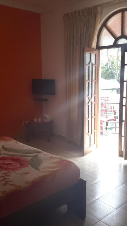 Postel nebo postele na pokoji v ubytování Kings Park villa