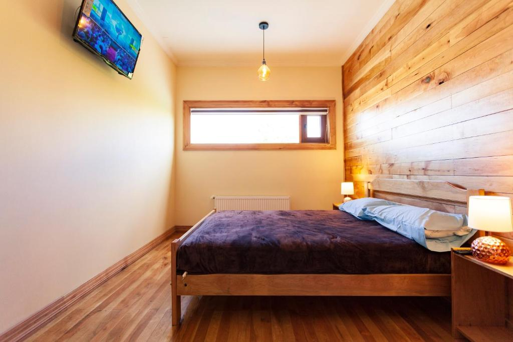 A bed or beds in a room at Hostal Boutique Patagonia Mística