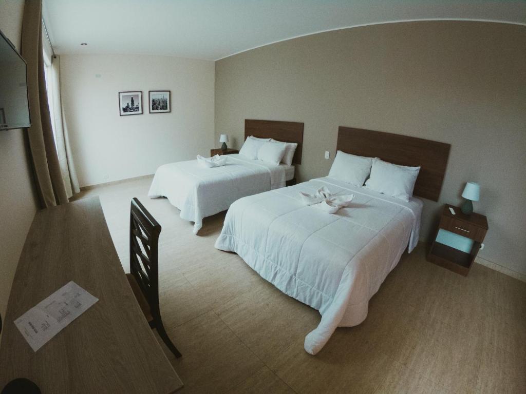 Letto o letti in una camera di Villa Oasis