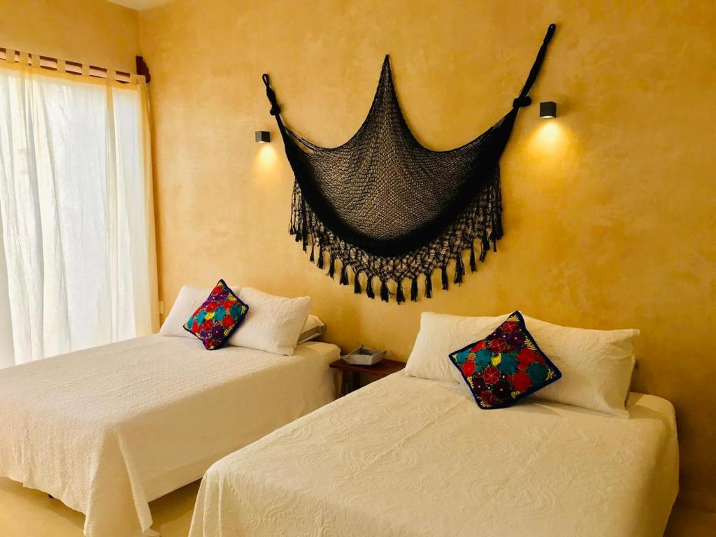 A bed or beds in a room at Casa Esperanza Harmony Tulum