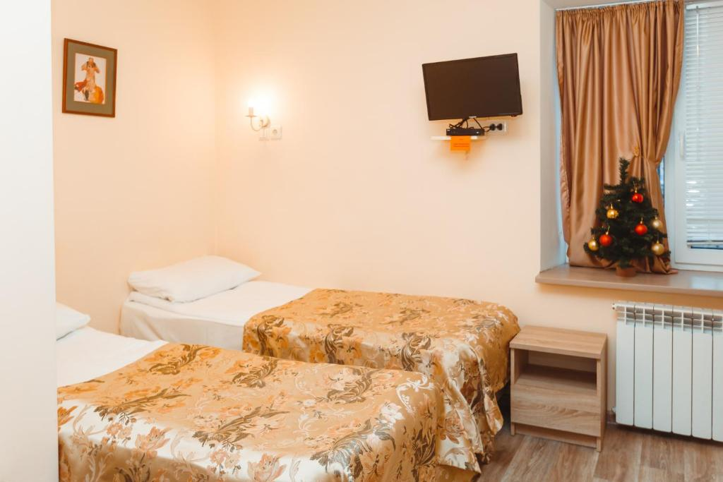 A bed or beds in a room at YouPiter apartments