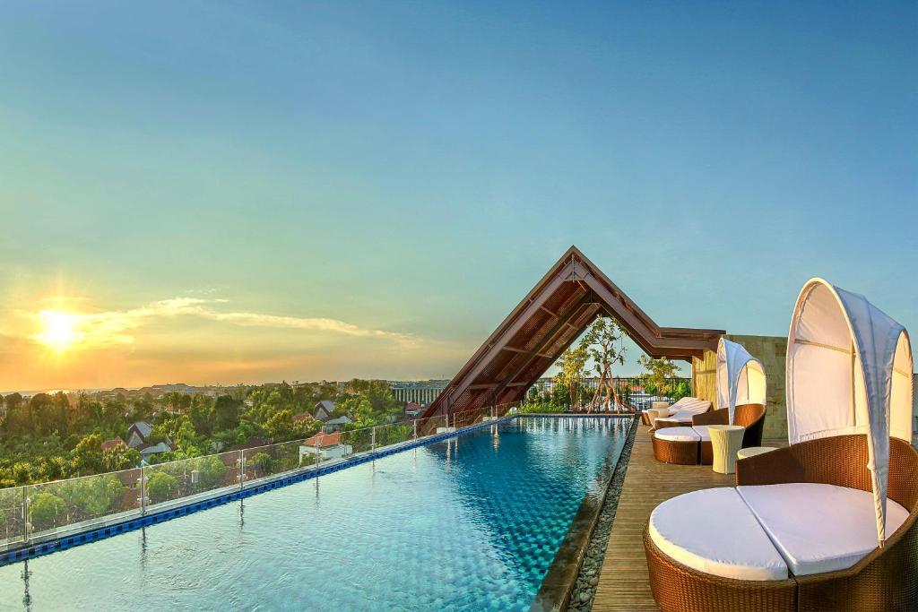 The swimming pool at or near Ibis Bali Legian Street