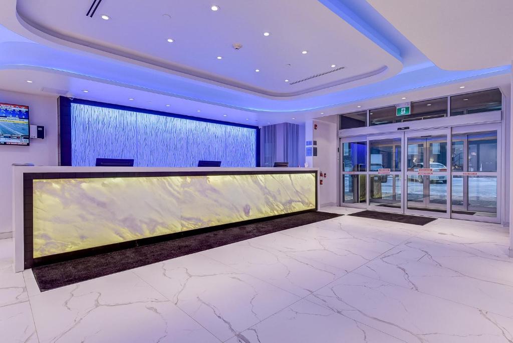 Лобби или стойка регистрации в EST Hotel