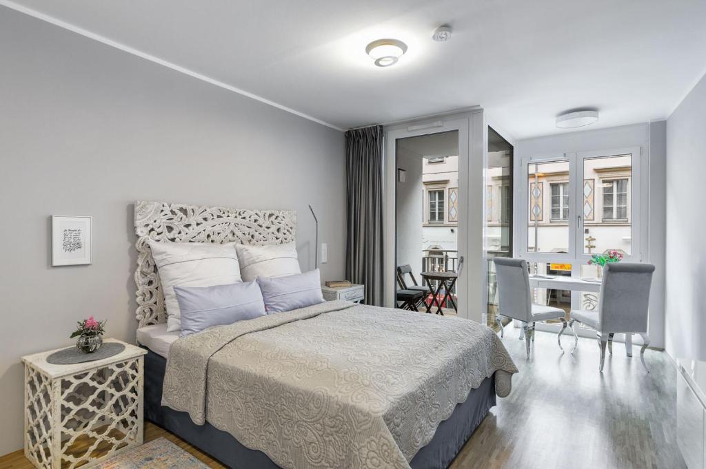 Ein Bett oder Betten in einem Zimmer der Unterkunft ELOUISA sweet HOME APPARTEMENTS