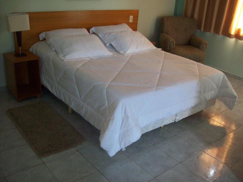 A bed or beds in a room at Presidente Hotel