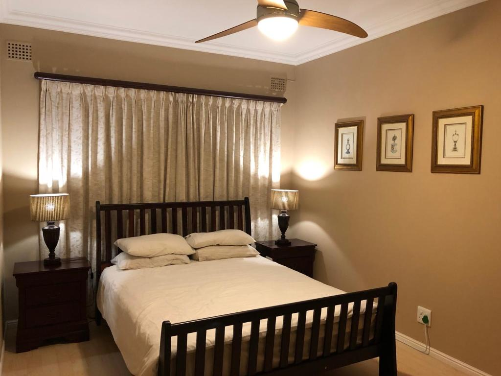 A bed or beds in a room at CENTRAL in the Suburbs