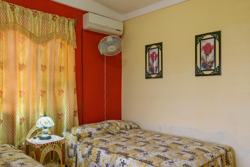 Letto o letti in una camera di Casa Dr. Panchito y Norma
