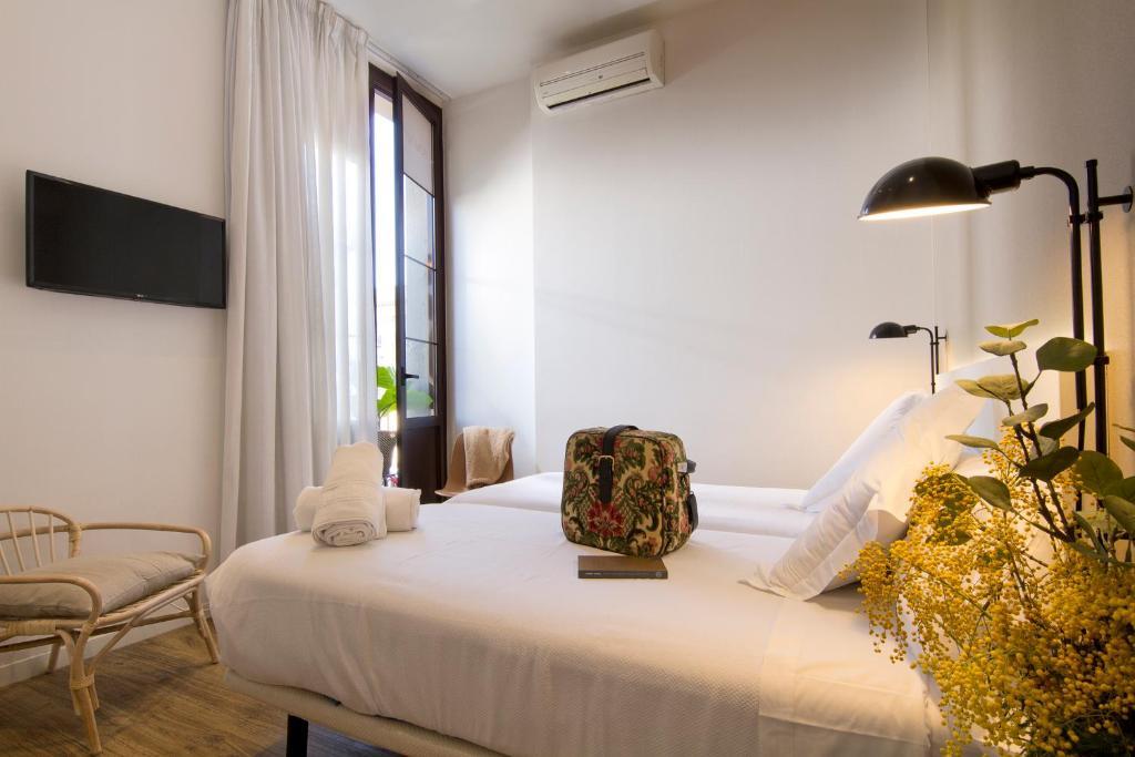 Cama o camas de una habitación en Som Nit Born
