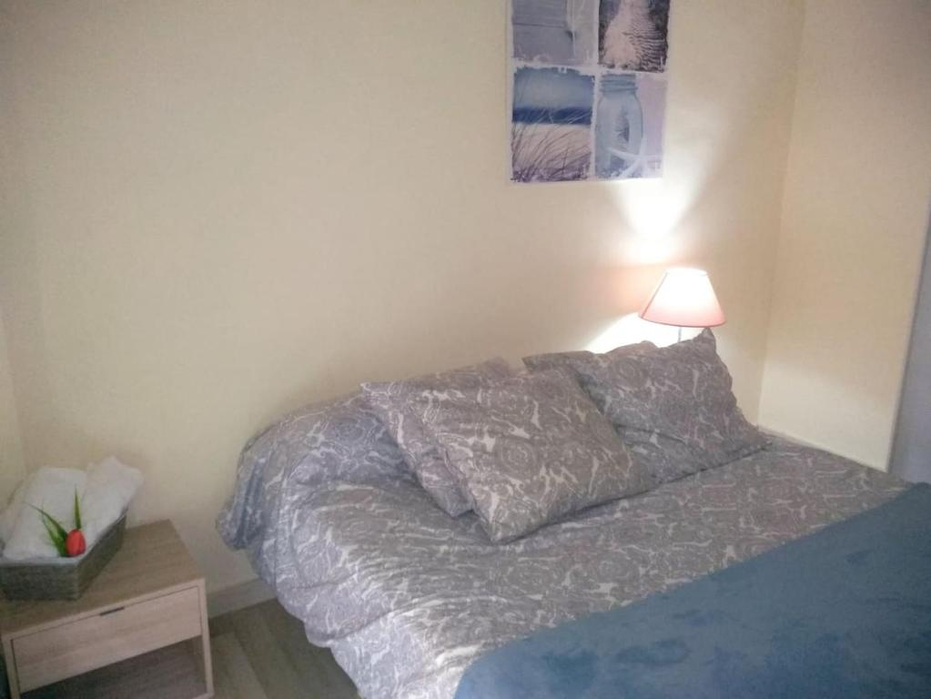 A bed or beds in a room at Calle del Laurel 24