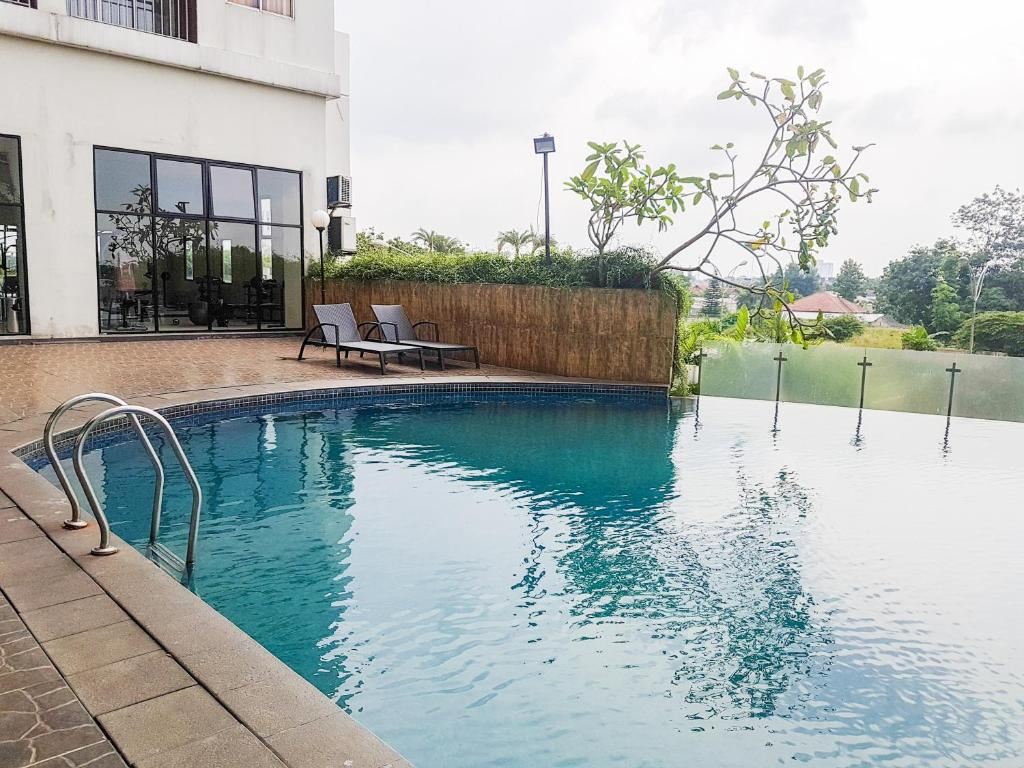 Brand New 2BR Serpong Greenview Apartment By Travelio